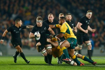 AUCKLAND, NEW ZEALAND - AUGUST 15: Kieran Read of the All Blacks is tackled  uring The Rugby Championship, Bledisloe Cup match between the New Zealand All Blacks and the Australian Wallabies at Eden Park on August 15, 2015 in Auckland, New Zealand.  (Photo by Phil Walter/Getty Images)