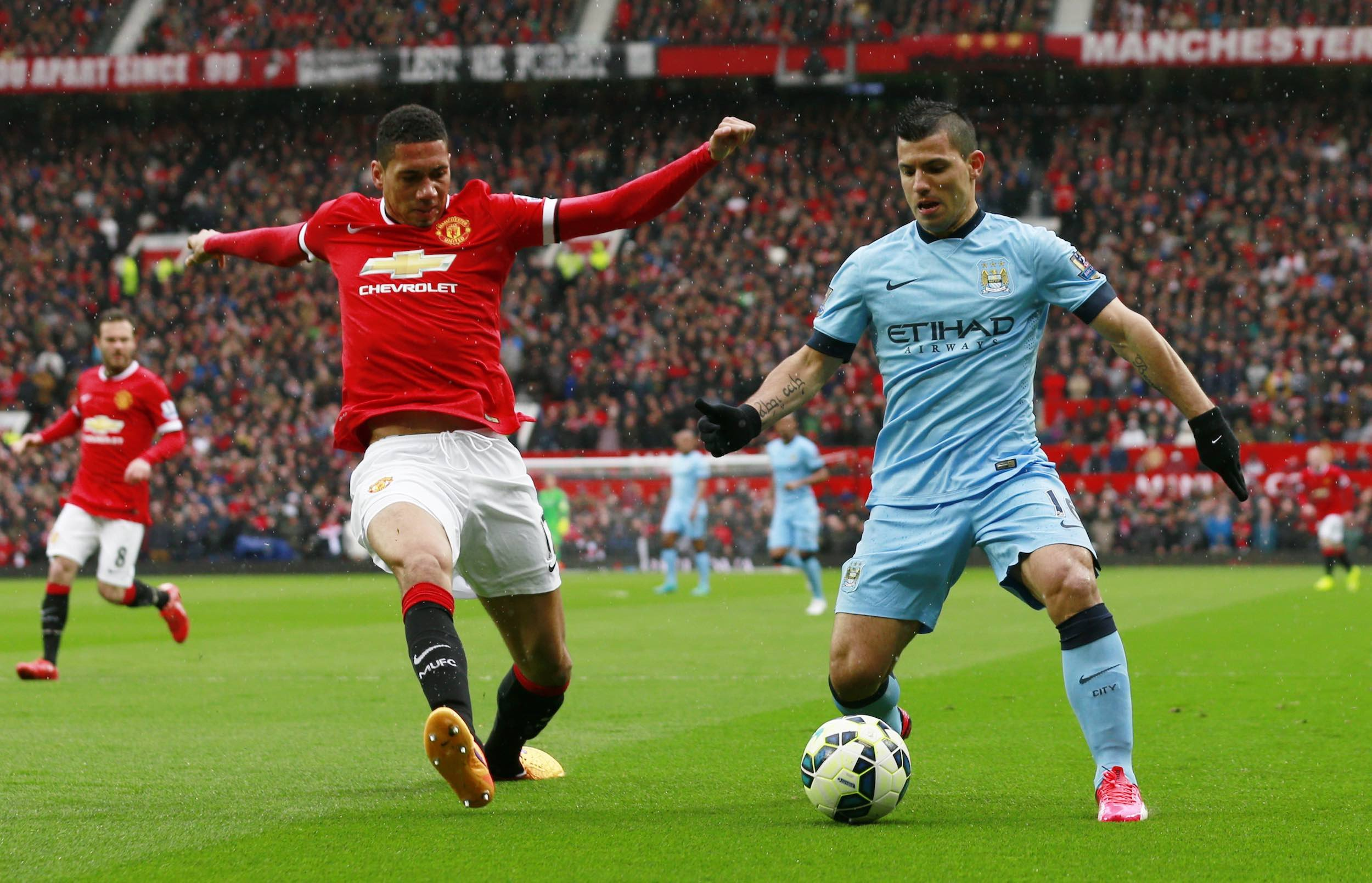 "Football - Manchester United v Manchester City - Barclays Premier League - Old Trafford - 12/4/15 Manchester United's Chris Smalling and Manchester City's Sergio Aguero in action Action Images via Reuters / Jason Cairnduff Livepic EDITORIAL USE ONLY. No use with unauthorized audio, video, data, fixture lists, club/league logos or ""live"" services. Online in-match use limited to 45 images, no video emulation. No use in betting, games or single club/league/player publications.  Please contact your account representative for further details."