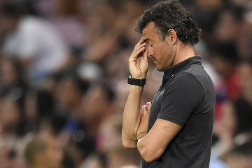 Barcelona's Spanish coach Luis Enrique reacts during a friendly football match between Barcelona and Napoli in Geneva on August 6, 2014.  AFP PHOTO / FABRICE COFFRINI        (Photo credit should read FABRICE COFFRINI/AFP/Getty Images)