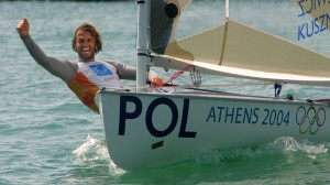 Poland's Mateusz Kusznerewicz sailing in Finn dinghy celebrates wining bronze medal in the Athens 2004 Olympic Games. Poland's Mateusz Kusznerewicz sailing in his Finn dinghy clinches his fist in celebration after wining bronze medal in the Athens 2004 Olympic Games regatta August 21, 2004. REUTERS/Peter Andrews