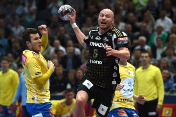 Kiel?s Henrik Lundstroem throws the ball during the Handball Champions League EHF Final Four third place match between Poland's KS Vive Tauron Kielce and Germany's THW Kiel in Cologne, western Germany on May 31, 2015. Poland's team placed third and won the match 28-26. AFP PHOTO / PATRIK STOLLARZ        (Photo credit should read PATRIK STOLLARZ/AFP/Getty Images)