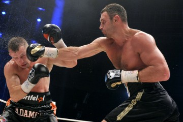World heavyweight champion Vitali Klitschko (R) fights against Poland's Tomasz Adamek during their heavyweight title boxing match in Wroclaw on September 10, 2011. Klitschko earned the 40th knock out of his career tonight when he stopped Polish challenger Tomasz Adamek in the tenth round to defend his WBC belt.     AFP PHOTO/ ADAM NURKIEWICZ (Photo credit should read ADAM NURKIEWICZ/AFP/Getty Images)