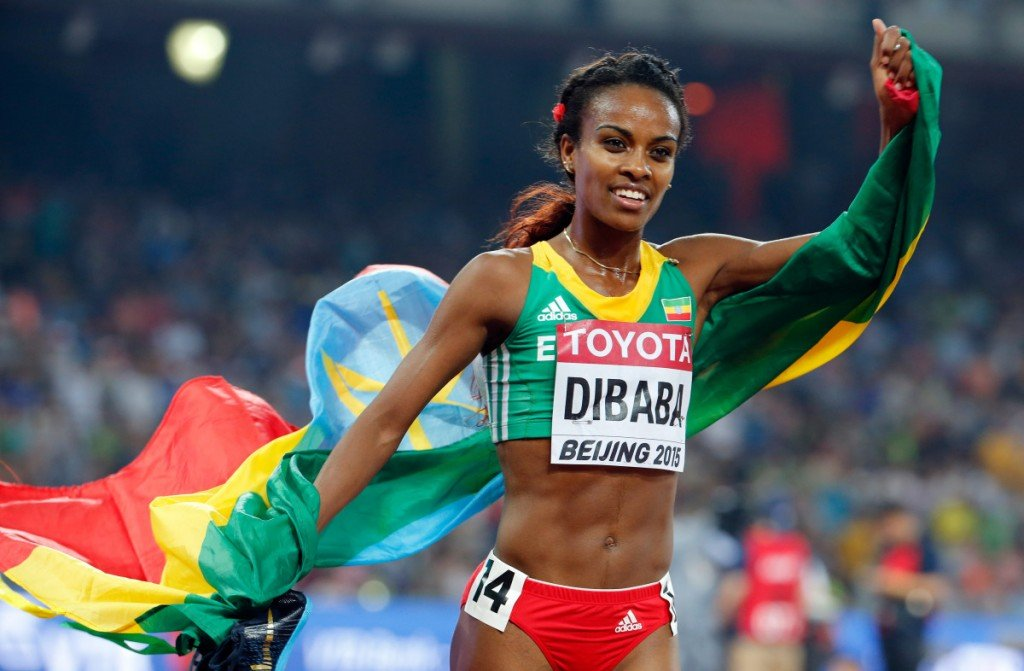 Ethiopia's Genzebe Dibaba celebrates after winning a bronze medal in the women's 5000m final at the World Athletics Championships at the Bird's Nest stadium in Beijing, Sunday, Aug. 30, 2015. (AP Photo/Ng Han Guan)