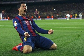 "Barcelona's Luis Suarez celebrates after scoring a goal against Real Madrid during their Spanish first division ""Clasico"" soccer match at Camp Nou stadium in Barcelona, March 22, 2015.        REUTERS/Albert Gea"